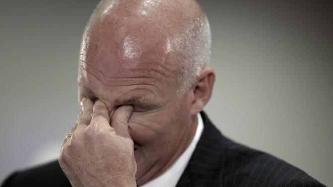 FILE - BP senior vice president Kent Wells rubs his eyes while testifying during the Deepwater Horizon joint investigation hearings by the U.S. Coast Guard and the Interior Department's Bureau of Ocean Management, Regulation and Enforcement in Houston in this Aug. 26, 2010 file photo. A high-stakes trial to assign blame and help figure out exactly how much more BP and other companies should pay for the spill began Monday, Feb. 25, 2013. (AP Photo/David J. Phillip, Pool, File)