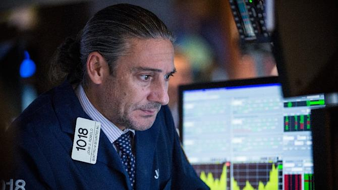 A trader works on the floor of the New York Stock Exchange during the afternoon of September 2, 2015