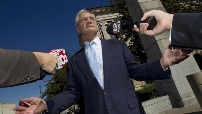 FILE - In this file photo taken Nov. 2, 2011, former Alabama Gov. Don Siegelman talks with reporters outside the Federal Courthouse in Montgomery, Ala. Siegelman is headed back to federal court Friday, Aug. 3, 2012, for a new sentencing hearing for his conviction on bribery and other charges. Judge Mark Fuller will decide Siegelman's new sentence in Montgomery and could order him to immediately return to federal prison after more than four years of freedom. (AP Photo/Dave Martin, File)