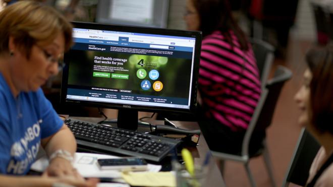 A Florida insurance agent helps a woman purchase a policy under the Affordable Care Act on Nov. 14.
