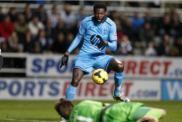 Tottenham Hotspur's Emmanuel Adebayor scores against Newcastle United during their English Premier League soccer match at St James' Park in Newcastle