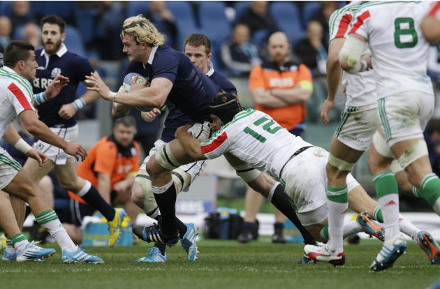 Scotland's Richie Gray, left, is tackled by Italy's Gonzalo Garcia during a Six Nations rugby union international match between Italy and Scotland, Saturday, Feb. 22, 2014. (AP Photo/Andrew Me