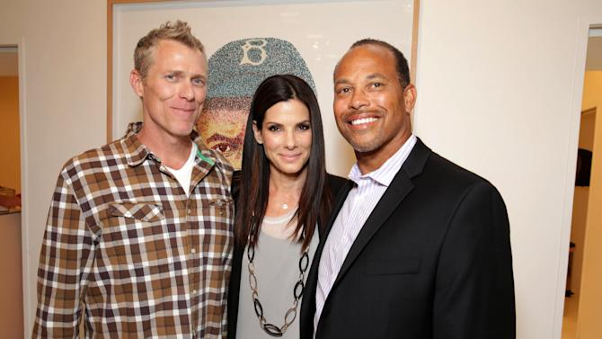 EXCLUSIVE CONTENT - PREMIUM RATES APPLY Artist Pat Riot, Sandra Bullock and Major League Baseball Scouting Bureaus' Darrell Miler at Artist Pat Riot's Art Exhibit, 'Out of Left Field' benefiting the MLB Urban Youth Academy on Thusday, May, 23rd, 2013 in Los Angeles. (Photo by Eric Charbonneau/Invision for Protagonist Brand Management/AP Images)