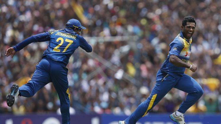 Sri Lanka's Prasanna celebrates with teammate Jayawardene after taking the wicket of Pakistan's Afridi during their final ODI cricket match in Dambulla