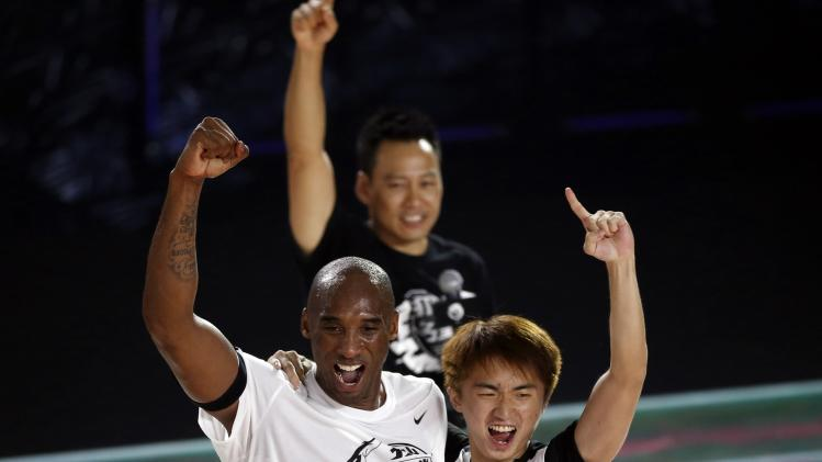 Kobe Bryant of NBA's Los Angeles Lakers attends a promotional event in Shanghai