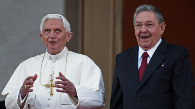 Pope Benedict XVI and Cuban President Raul Castro walk outside the Revolution palace at the end of their meeting in Havana, Tuesday, March 27, 2012.  The meeting took place behind closed doors on the pontiff's second day on the island.(AP Photo/Gregorio Borgia)