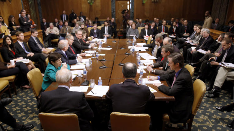 The Commission on Fiscal Responsibility and Reform meets on Capitol Hill in Washington, Friday, Dec. 3, 2010. (AP Photo/Harry Hamburg)