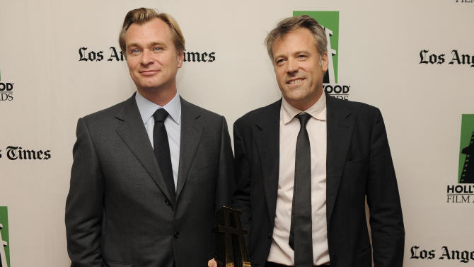 """Wally Pfister, right, recipient of the Hollywood Cinematographer Award for the film """"The Dark Knight Rises,"""" poses with the film's director Christopher Nolan backstage at the 16th Annual Hollywood Film Awards Gala on Monday, Oct. 22, 2012, in Beverly Hills, Calif. (Photo by Chris Pizzello/Invision/AP)"""