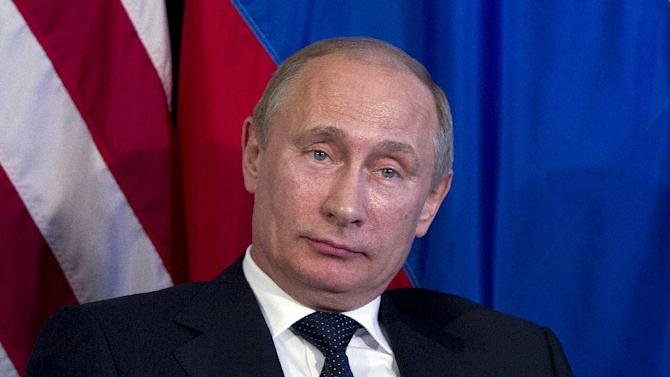 Russia's President Vladimir Putin pauses for translation during a bilateral meeting with President Barack Obama during the G20 Summit, Monday, June 18, 2012, in Los Cabos, Mexico. (AP Photo/Carolyn Kaster)
