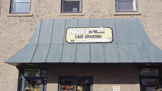 """This undated photo provided by the Regional Transportation Authority in Chicago shows a hair braiding business in Kankakee, Ill., that the Chicago area transportation agency alleged Wednesday, April 17, 2013, is a """"sham"""" office, one of dozens set up in a scheme by major companies or their subsidiaries, including AT&T, Land's End, Target and Southwest Airlines, in the Northern Illinois communities of Channahon and Kankakee to avoid paying millions of dollars in taxes in Chicago and Cook County. The RTA, which relies on sales taxes for funds, has sued the two communities. (AP Photo/Regional Transportation Authority)"""