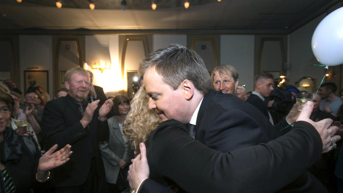 Progressive Party chief Sigmundur David Gunnlaugsson hugs a supporter following general elections on Saturday, April 27, 2013, in Reykjavik, Iceland. Five years after Iceland's economic collapse, early returns signaled that voters are favoring the return of a center-right, Eurosceptic government, widely blamed for the nation's financial woes. (AP Photo/Brynjar Gauti)