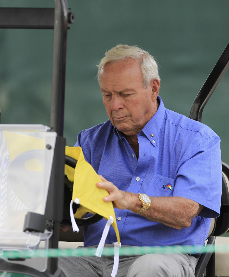 Arnold Palmer signs autographs while sitting in his golf cart during the third round of the Arnold Palmer Invitational golf tournament at Bay Hill, Saturday, March 24, 2012, in Orlando, Fla. (AP Photo/John Raoux)