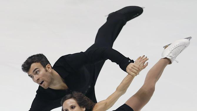 Meagan Duhamel and Eric Radford of Canada perform during the pairs free skating of the NHK Trophy figure skating in Osaka, western Japan, Saturday, Nov. 29, 2014. (AP Photo/Shizuo Kambayashi)