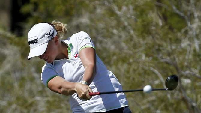 Stacy Lewis hits her tee shot at the fifth hole during the final round of the LPGA Founders Cup golf tournament on Sunday, March 17, 2013, in Phoenix. (AP Photo/Ross D. Franklin)