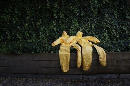 Protective suits are left to dry after an Ebola training session held by Spain's Red Cross in Madrid