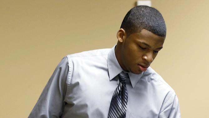 Ma'lik Richmond, 16, arrives for the start of his trial in juvenile court, where he and Trent Mays, 17,  face rape charges on Wednesday, March 13, 2013 in Steubenville, Ohio.  Richmond and Mays are accused of raping a 16-year-old West Virginia girl last August 2012.  (AP Photo/Keith Srakocic, Pool)