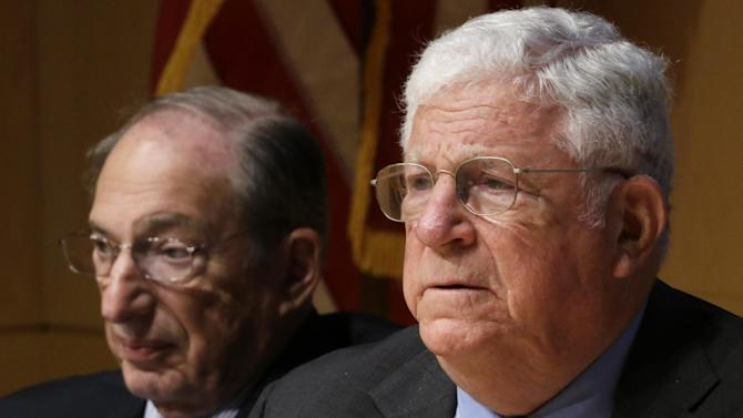 Former Federal Reserve Bank chairman, Paul Volcker, right, and task force advisory board member Richard P. Nathan, listen to Philadelphia Mayor Michael Nutter speak during a meeting of the State Budget Crisis Task Force at the National Constitution Center, Tuesday, June 25, 2013, in Philadelphia. The event is designed to bring attention to the eroding financial condition of state governments. (AP Photo/Matt Rourke)
