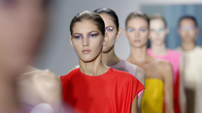 Models wear creations from Belgian fashion designer Raf Simons for Dior ready to wear Spring-Summer 2013 collection, presented in Paris, Friday, Sept. 28, 2012. (AP Photo/Jacques Brinon)