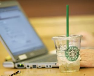 AP Photo: Starbucks will begin offering free Wi-Fi on July 1.