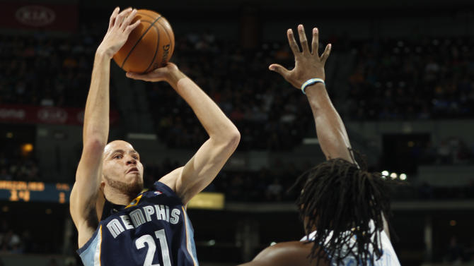 Memphis Grizzlies forward Tayshaun Prince, left, shoots over Denver Nuggets forward Kenneth Faried in the first quarter of an NBA basketball game in Denver, Friday, March 15, 2013. (AP Photo/David Zalubowski)