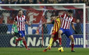 Barcelona's Jordi Alba fights for the ball with Atletico Madrid's Diego Costa during their Spanish first division soccer match at the Vicente Calderon stadium in Madrid