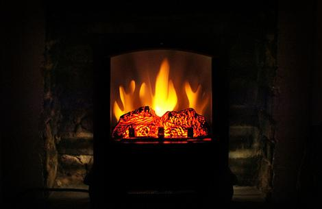 Electric vs. wood fireplaces: Key benefits and drawbacks of each