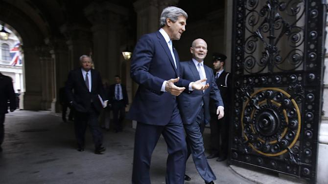 U.S. Secretary of State John Kerry, left, walks toward 10 Downing Street with British Foreign Secretary William Hague, for a meeting with British Prime Minister David Cameron, not pictured, in London on Monday, Feb. 25, 2013, during Kerry's first official trip overseas as secretary. (AP Photo/Jacquelyn Martin, Pool)