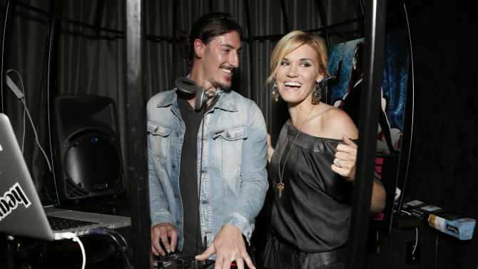 "COMMERCIAL IMAGE:  Eric Balfour, left, DJ's with Emily Rose at the Entertainment One  ""Haven"" Party at Comic Con 2012 on Thursday, July 12, 2012 in San Diego. (Photo by Todd Williamson/Invision for eOne/AP Images)"