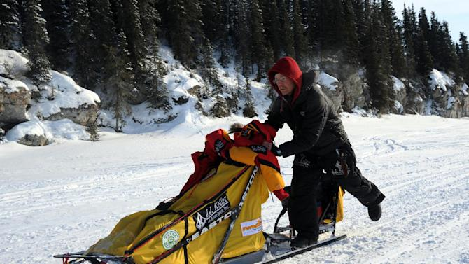 Mitch Seavey leaves White Mountain in Alaska, Tuesday, March 12, 2013, during the Iditarod Trail Sled Dog Race. (AP Photo/The Anchorage Daily News, Bill Roth)  LOCAL TV OUT (KTUU-TV, KTVA-TV) LOCAL PRINT OUT (THE ANCHORAGE PRESS, THE ALASKA DISPATCH)