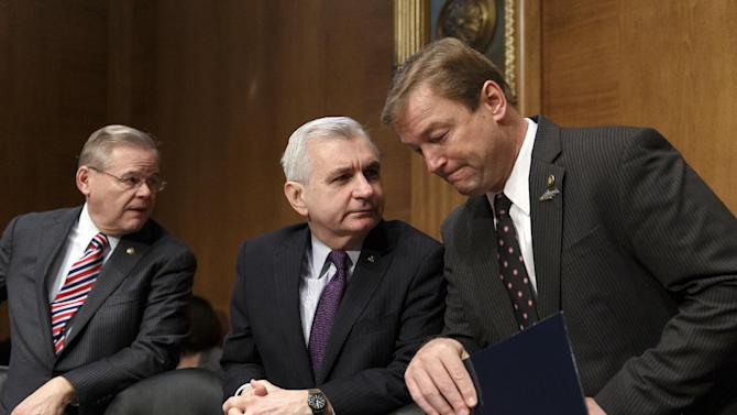 "In this Feb. 27, 2014, file photo, Sen. Jack Reed, D-R.I., center, confers with Sen. Dean Heller, R-Nev., right, with Sen. Robert Menendez, D-N.J., at far left, as members of the Senate Banking Committee gather for an appearance by Janet Yellen on Capitol Hill in Washington. One partisan election-year battle that senators seem likely to resolve when they return from recess later this month is the fight over renewing expired benefits for the long-term unemployed. Reed, a leading bargainer, said the March 13 agreement would help families and ""provide a little certainty to families, business and the markets that Congress is capable of coming together to do the right thing."" (AP Photo/J. Scott Applewhite, File)"