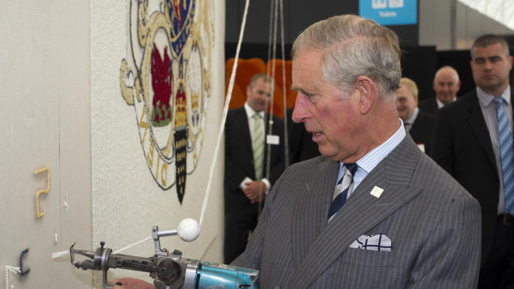 Britain's Prince Charles attempts to do some tufting during his visit to the New Zealand Shear Brilliance Event, The Cloud, Auckland, New Zealand, Monday, Nov. 12, 2012. (AP Photo/SNPA, David Rowland) NEW ZEALAND OUT