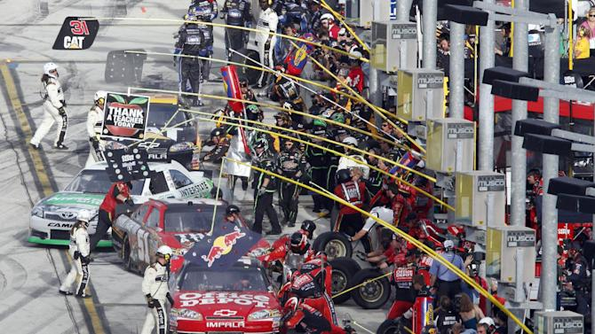 Drivers make pit stops during the NASCAR Sprint Cup Series auto race at Homestead-Miami Speedway in Homestead, Fla., Sunday, Nov. 20, 2011. (AP Photo/David Graham)