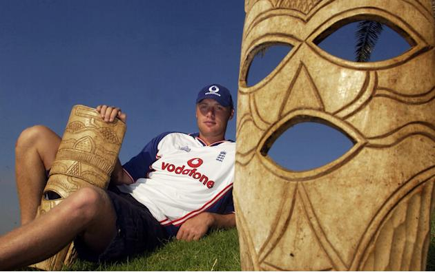 PORT ELIZABETH, SOUTH AFRICA - FEBRUARY 27:   Andrew Flintoff of England poses with African masks after a press conference at the Holiday Inn in Port Elizabeth, South Africa on February 27, 2003. (Pho
