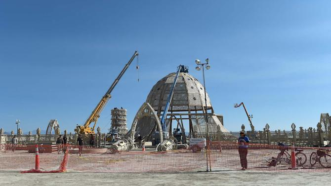 Artists and volunteers work on the Temple of Grace at the annual Burning Man event on the Black Rock Desert of Gerlach, Nev, on Aug. 24, 2014, a day before the event opens to ticket holders. (AP Photo/Reno Gazette-Journal, Andy Barron) NO SALES; NEVADA APPEAL OUT; SOUTH RENO WEEKLY OUT