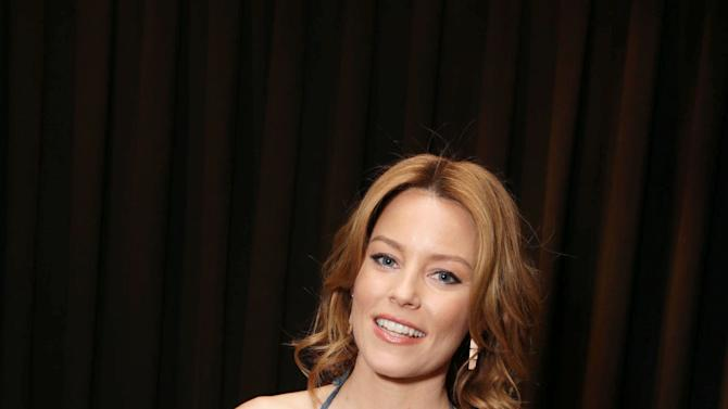 """Elizabeth Banks, cast member in the upcoming film """"The Hunger Games: Catching Fire""""  at Lionsgate Presentation at 2013 CinemaCon, on Thursday, April, 18th, 2013 in Las Vegas. (Photo by Eric Charbonneau/Invision for Lionsgate/AP Images)"""