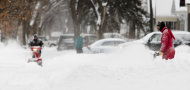 Jeff Gerst, right, joins his neighbors in clearing snow from around their homes Monday, Feb. 11, 2013, in Fargo, N.D. Schools, public offices, medical centers and businesses throughout the eastern Dakotas opened late or not at all Monday as the region began digging out from a blizzard that broke several longstanding weather records. (AP Photo/The Forum, Michael Vosburg)