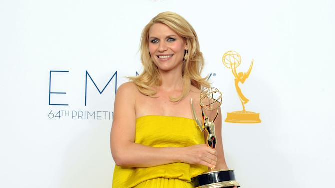 Actress Claire Danes, winner Outstanding Lead Actress In A Drama Series for 'Homeland', poses backstage at the 64th Primetime Emmy Awards at the Nokia Theatre on Sunday, Sept. 23, 2012, in Los Angeles. (Photo by Jordan Strauss/Invision/AP)