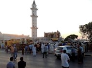 Libyans gather as Islamist hardliners bulldoze the mausoleum of Al-Shaab Al-Dahman near the centre of Tripoli. Hardline Sunni Islamists are implacably opposed to the veneration of tombs of revered Muslim figures, saying that such devotion should be reserved for God alone