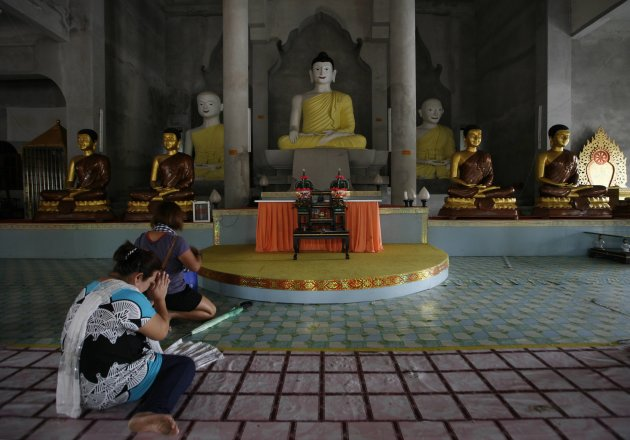 Buddhist devotees recite prayers during Vesak Day at a temple in Bachok