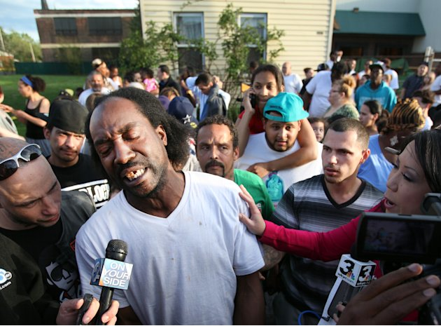 FILE - This May 6, 2013 file photo shows neighbor Charles Ramsey speaking to media near the home where missing women Amanda Berry, Gina DeJesus and Michele Knight were rescued in Cleveland. Ramsey, th