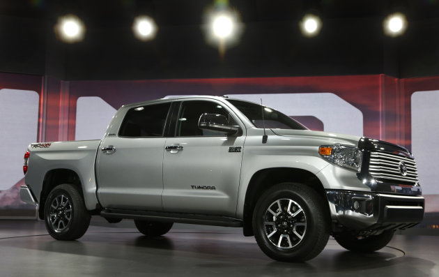 The redesigned 2014 Toyota Tundra is eunveiled at the Chicago Auto Show Thursday, Feb. 7, 2013, in Chicago. (AP Photo/Charles Rex Arbogast)