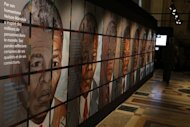 "A visitor walks past drawings of Nelson Mandela at the exhibition ""Nelson Mandela, from Prisoner to President"" in Paris on May 29, 2013. Mandela was in a ""serious but stable"" condition in hospital on Saturday night with a renewed lung infection that has triggered worldwide concern for the South African hero"