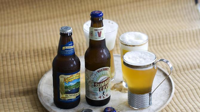 In this image taken on June 3, 2013, Summerfest, left, and Summer Love Ale are shown in Concord, N.H. (AP Photo/Matthew Mead)