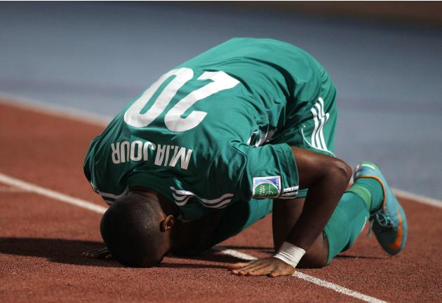 Raja Casablanca's Iajour prays as he celebrates his goal against Atletico Mineiro during their FIFA Club World Cup semi-final soccer match at Marrakech stadium