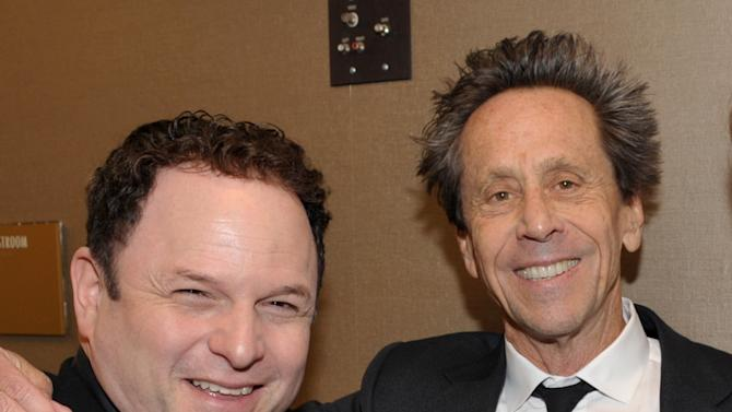 Actor Jason Alexander, left, and producer Brian Grazer poses at the 21st Annual 'A Night at Sardi's' to benefit the Alzheimer's Association at the Beverly Hilton Hotel on Wednesday, March 20, 2013 in Beverly Hills, Calif. (Photo by John Shearer/Invision for Alzheimer's Association/AP Images)