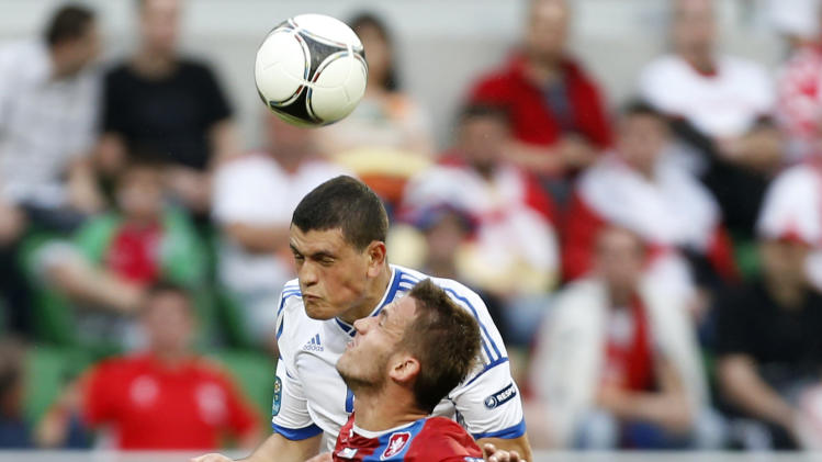 Greece's Kyriakos Papadopoulos, top, and Czech Republic's Tomas Pekhart go for the ball during the Euro 2012 soccer championship Group A match between Greece and Czech Republic in Wroclaw, Poland, Tuesday, June 12, 2012. (AP Photo/Jon Super)