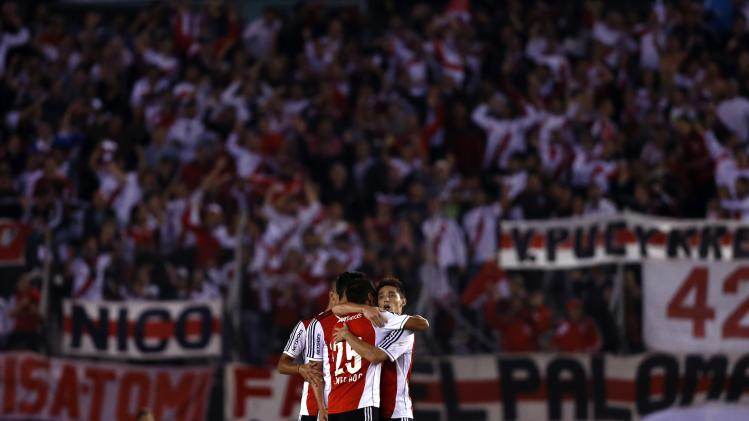 River Plate's players celebrate their victory against Velez Sarsfield in their Argentine First Division soccer match in Buenos Aires