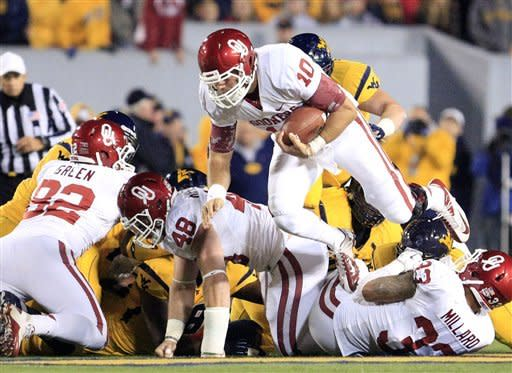 No. 13 Oklahoma beats West Virginia 50-49