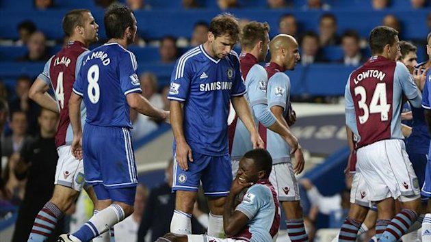 Aston Villa's Christian Benteke (ground) holds his jaw after a challenge by Chelsea's Branislav Ivanovic (Reuters)