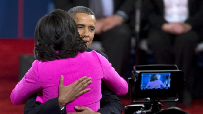 President Barack Obama embraces first lady Michelle Obama on stage after the second presidential debate, Tuesday, Oct. 16, 2012, at Hofstra University in Hempstead, N.Y. (AP Photo/Carolyn Kaster)